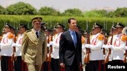 Tổng thống Syria Bashar al-Assad trước khi tuyên thệ nhậm chức ở dinh tổng thống cho nhiệm kỳ mới bảy năm, 16/7/2014. (Ảnh: Cơ quan thống tấn quốc gia Syria SANA)