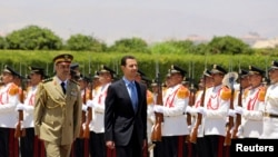 Syria's President Bashar al-Assad reviews a guard of honor before his swearing-in for a new seven-year term at the presidential palace in Damascus, July 16, 2014, in this picture released by Syria's national news agency SANA.