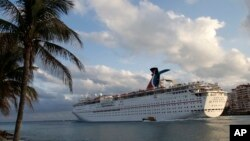 FILE - The Carnival Imagination cruise ship leaves the Port of Miami. Carnival cruise lines says it will allow Cuban-born passengers to book travel to Cuba.