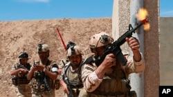 Avstraliya və Yeni Zelandiyanın koalisiya qüvvələri Bağdadın şimalında yerləşən Taci bazasında İraq ordusunun əsgərləri ilə birlikdə təlim missiyasında iştirak edir. 17 aprel 2019.