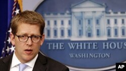 U.S. White House Press Secretary Jay Carney in the briefing room in Washington, January 18, 2012