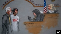 In this courtroom sketch, Khairullozhon Matanov (second from left) with attorney Paul Glickman (L) appears in federal court before Magistrate Judge Marianne B. Bowler (R), in Boston, May 30, 2014.