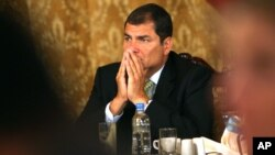 Ecuador's President Rafael Correa gestures during a news conference with the international press at the government palace in Quito, Ecuador, Wednesday Oct. 6, 2010. Correa contends the Sept. 30 police revolt, which trapped him in a hospital for over 12 h