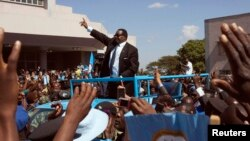 Malawi's President Peter Mutharika of the Democratic Progressive Party waves to supporters after he was sworn in in Blantyre, May 31, 2014.