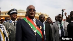Burkina Faso President Roch Marc Kabore leaves his swearing in ceremony in Ouagadougou