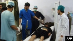 Medical staff attend to a victim of the blast at the main hospital in Kunduz January 26, 2013.