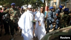 FILE - Gambian President Yahya Jammeh arrives at a polling station with his wife Zineb during presidential elections in Banjul, Gambia, Dec. 1, 2016. Jammeh has been demanding that the poll results be nullified.