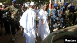 FILE - Gambian President Yahya Jammeh arrives at a polling station with his wife, Zineb, during the presidential election in Banjul, Gambia, Dec. 1, 2016.