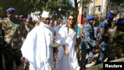 FILE - Yahya Jammeh arrives at a polling station with his wife Zineb during the presidential election in Banjul, Gambia, Dec. 1, 2016.