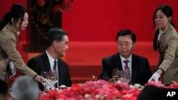 Hong Kong Chief Executive Leung Chun-ying, left, looks at Zhang Dejiang, right, chairman of China's National People's Congress, during a banquet in Hong Kong, Wednesday, May 18, 2016.