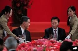 Hong Kong Chief Executive Leung Chun-ying (l) looks at Zhang Dejiang (r) chairman of China's National People's Congress, during a banquet in Hong Kong on May 18, 2016.
