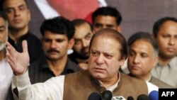Pakistan's incoming Prime Minister Nawaz Sharif addresses his party's newly elected MPs in Lahore on May 20, 2013