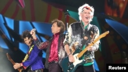 Keith Richards (R), Mick Jagger (C) and Ronnie Wood of the Rolling Stones perform a free outdoor concert at Ciudad Deportiva de la Habana sports complex in Havana, Cuba, March 25, 2016. The legendary rockers say they have never given permission to Donald Trump's presidential campaign to use their songs.