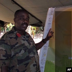 """Col B briefs senior officers on the most recent engagements with the LRA, spanning DRC, Central African Rep. and S. Sudan. The map was marked """"Secret"""" so we blurred it a bit (file photo)"""