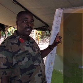 "Col B briefs senior officers on the most recent engagements with the LRA, spanning DRC, Central African Rep. and S. Sudan. The map was marked ""Secret"" so we blurred it a bit (file photo)"