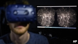 Hadrien Gurnel, software engineer at EPFL's Laboratory for Experimental Museology, explores with a virtual reality headset the most detailed 3D map of the universe with the virtual reality software VIRUP, on Tuesday, Oct. 12, 2021, in St-Sulpice near Laus