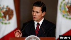 FILE - Mexico's President Enrique Pena Nieto speaks to the audience during a meeting with members of the Diplomatic Corps in Mexico City, Mexico.