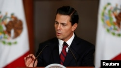 FILE - Mexico's President Enrique Pena Nieto speaks to the audience during a meeting with members of the Diplomatic Corps in Mexico City, Mexico, Jan. 11, 2017..
