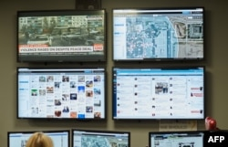 FILE - After reports of threats, Mall of America Director of Security Major Doug Reynolds explains the social media monitoring team during a tour of the mall's security systems in Bloomington, Minn., Feb. 23, 2015.