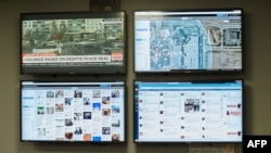 FILE - Mall of America Director of Security Major Doug Reynolds explains the social media monitoring team during a tour of Mall of America security systems in Bloomington, Minnesota, February 23, 2015.