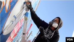"""Graffiti artist Cita Sadeli, aka Chelove, spray-paints a mural in a recent episode of ZirZameen."""