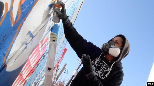 """Graffiti artist Cita Sadeli, aka Chelove, spray-paints a mural in a recent episode of ZirZameen."""