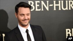 """Jack Huston, the star of """"Ben-Hur,"""" winks at photographers at the premiere of the film at the TCL Chinese Theater IMAX, Aug. 16, 2016, in Los Angeles."""