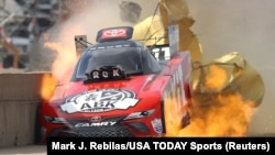 In Texas, race car driver Alexis DeJoria suffers an engine fire after winning her first-round matchup during the Fall Nationals at Texas Motorplex. She was uninjured in the fiery incident, Oct 18, 2020. (Mark J. Rebilas/USA TODAY Sports/Reuters)