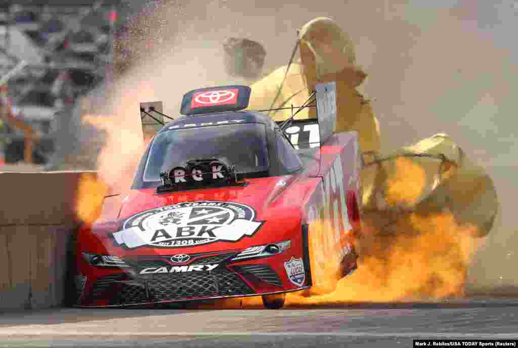 NHRA car driver Alexis DeJoria suffers an engine fire after winning her first round matchup during the Fall Nationals at Texas Motorplex in Ennis, Texas, Oct. 18, 2020. DeJoria was uninjured in the fiery incident.