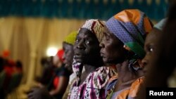 FILE - Parents of the Chibok girls attend a meeting with Nigeria's President Muhammadu Buhari at the presidential villa in Abuja, Nigeria, Jan. 14, 2016. Nigeria's information minister denied reports the Islamist militant group Boko Haram is demanding $50 million from the government as ransom before releasing the abducted Chibok schoolgirls.
