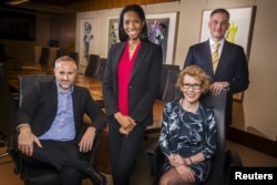 FILE - From left, Daniel Maury, Lanaya Irvin, Jennifer MacDonald and Matt Koehler, pictured in New York, April 13, 2015, were among LGBT activists in finance who helped persuade several Wall Street firms to sign a brief on behalf of businesses that back gay marriage.