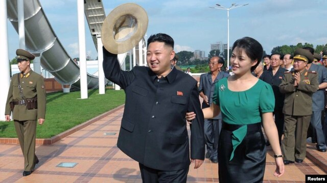 North Korean leader Kim Jong-Un and his wife Ri Sol-Ju attend the opening ceremony of the Rungna People's Pleasure Ground on Rungna Islet in Pyongyang in this July 25, 2012 photograph released by the North's KCNA.
