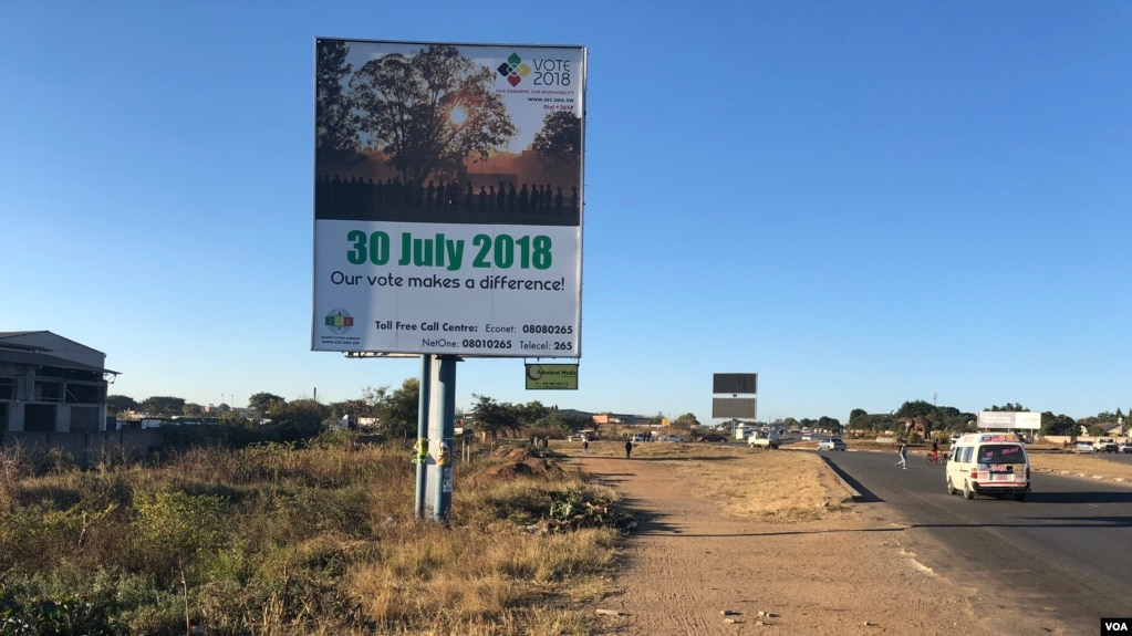 Cars and people pass a Zimbabwe Electoral Commission billboard in Harare, July 23, 2018, urging people to go and vote on July 30 and decide their future. (S. Mhofu/VOA)