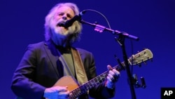 """FILE - In this April 23, 2014 file photo, musician Bob Weir performs at the premiere of """"The Other One: The Long, Strange Trip of Bob Weir"""" during the 2014 Tribeca Film Festival in New York."""