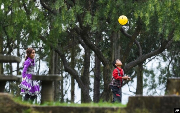 Young Syrian refugees play in the garden of their new temporary residence, the Catholic Marista Brothers of San Jose home, on the outskirts of Montevideo, Uruguay, Oct. 9, 2014.