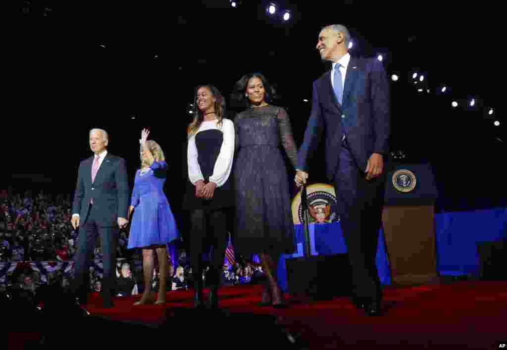 President Barack Obama walks on stage with First Lady Michelle Obama, daughter Malia, Vice President Joe Biden and his wife Jill Biden after his farewell address at McCormick Place in Chicago,  Illinois, Jan. 10, 2017.