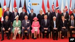 Britain's Queen Elizabeth II, accompanied by The Prince of Wales, pose for a formal photograph with leaders of the other Allied Nations ahead of the National Commemorative Event commemorating the 75th anniversary of D-Day, in Portsmouth, England, June 5,