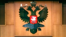 FILE - The Russian Double-headed Eagle is displayed inside the Foreign Ministry Building in Moscow.