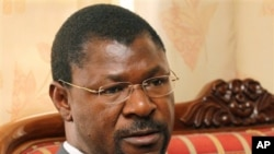 FILE-In this file photo taken Thursday, July 8, 2010 Kenyan Foreign Affairs Minister Moses Wetangula is seen during an interview with The Associated Press in Nairobi, Kenya. Wetangula quit his Cabinet post on Wednesday, Oct. 27, 2010 to allow investigatio