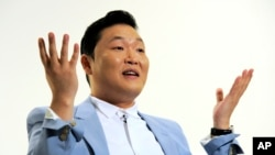 FILE - South Korean musical performer Psy speaks during an interview in Los Angeles.