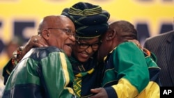 Winnie Madikizela-Mandela, centre, hugs front runner and Deputy President, Cyril Ramaphosa, right, and President Jacob Zuma, left, at the start of the ruling African National Congress (ANC) elective conference in Johannesburg, South Africa, Dec. 16 2017.