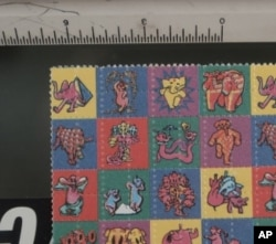 "DEA-confiscated LSD soaked ""blotter"" of the type often used by the 1960s counterculture."