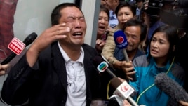 Ji Zhongji, cries as he speaks to journalists about his brother, Ji Zhongxing, who is on trial for endangering public safety by setting off an explosion two months ago at Beijing's airport, outside a courthouse in Beijing, Sept. 17, 2013.