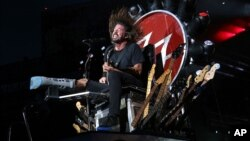 FILE - The rock band Foo Fighters — member Dave Grohl is pictured above, in a performance at New York's Citi Field — was one of a number of musical acts that canceled Paris shows in the wake of terrorist attacks that occurred Nov. 13, 2015.