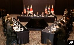 FILE - Delegation of South Korea, center, the United States and Japan, right, attend their trilateral meeting to coordinate strategies on North Korea, in Seoul, South Korea, Dec. 13, 2016.