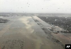 This Monday, Sept. 2, 2019 photo released by the U.S. Coast Guard Station Clearwater, shows flooding on the runway of the Marsh Harbour Airport in the Bahamas.