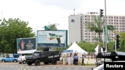 An armored vehicle is stationed outside the venue for the World Economic Forum on Africa (WEFA) meeting in Abuja, May 7, 2014.