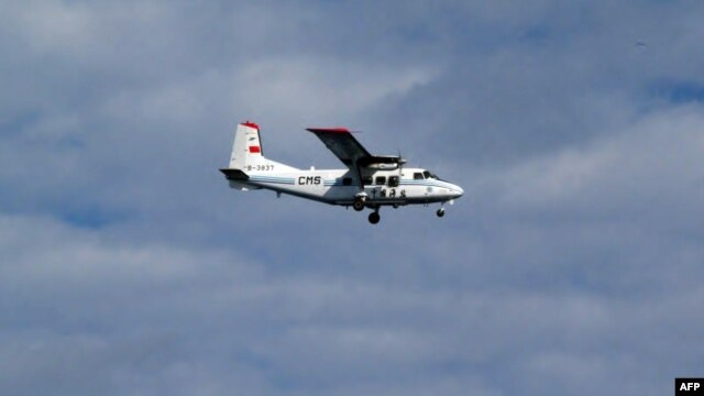 Handout picture taken by Japan Coast Guard shows a Chinese state-owned plane flying in airspace over the disputed island, called the Senkakus in Japanese and Diaoyus in Chinese, in the East China Sea, December 13, 2012