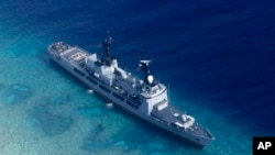 FILE - In photo provided by the Armed Forces of the Philippines, Aug. 29, 2018, shows the Philippine Navy ship BRP Gregorio del Pilar after it ran aground during a routine patrol in the vicinity of Half Moon Shoal, which is called Hasa Hasa in the Philippines, off the disputed Spratlys Group of islands in the South China Sea.