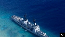 FILE - In photo provided by the Armed Forces of the Philippines, Aug. 29, 2018, shows the Philippine Navy ship BRP Gregorio del Pilar after it ran aground during a routine patrol in the vicinity of Half Moon Shoal, which is called Hasa Hasa in the Philipp